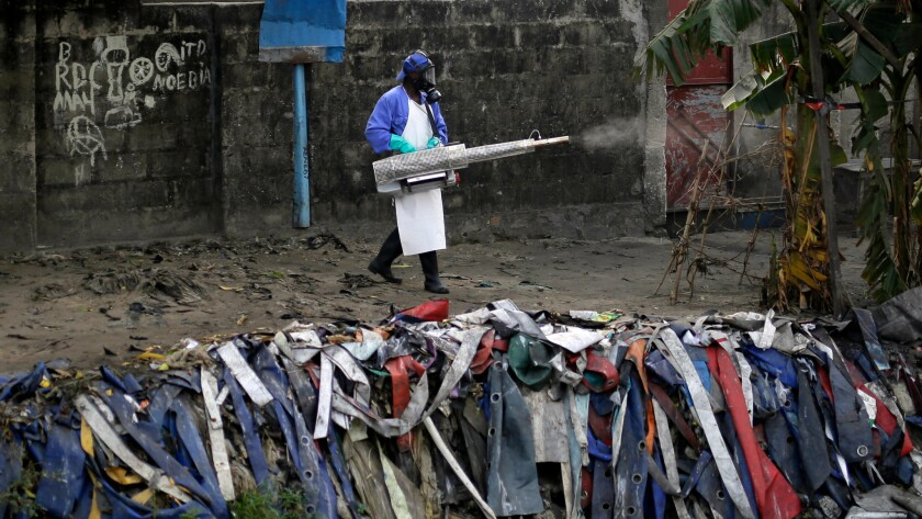 A member of a Doctors Without Borders team fumigates the Yolo Sud neighborhood of Kinshasa.