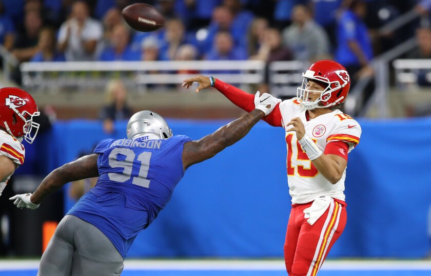Kansas City Chiefs quarterback Patrick Mahomes passes over Detroit Lions defensive tackle A'Shawn Robinson during the fourth quarter.