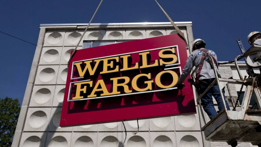 ARLINGTON, VA -MAY 11: Wachovia begins the transition into Wells Fargo at an Arlington VA branch off
