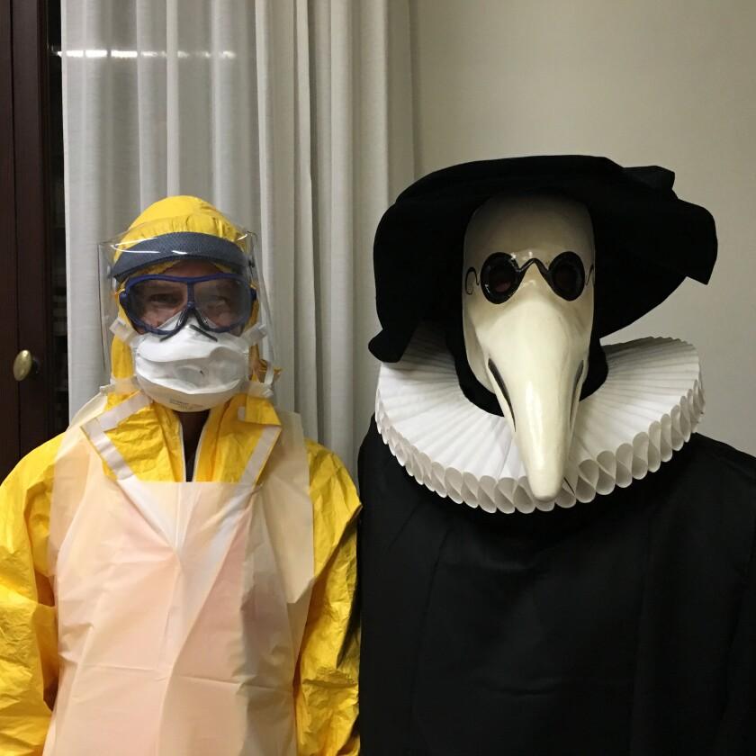 Geoff Manaugh and Dr. Luigi Bertinato wearing plague gear from different eras.