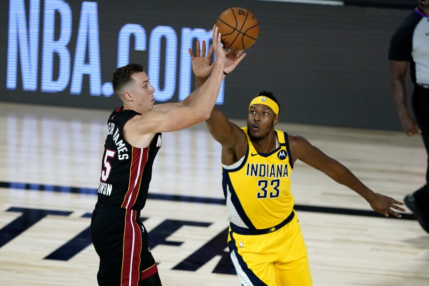 Heat forward Duncan Robinson has his shot challenged by Pacers center Myles Turner during the first half Aug. 20, 2020.