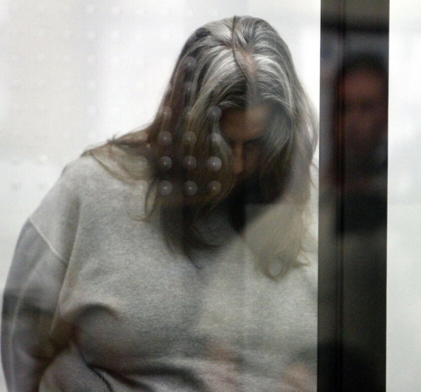 Elizabeth Ann Masters, 45, who admitted embezzling $5.7 million from her San Marcos employer during her nine years with the firm, kept her head lowered during her sentencing at the Vista Courthouse on Monday.