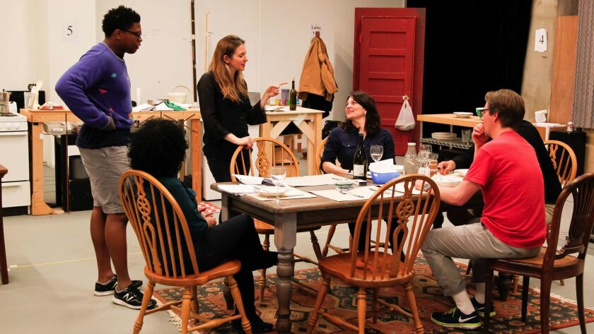 """Director Gaye Taylor Unchurch (standing, center) works with the cast during a """"Blameless"""" rehearsal."""