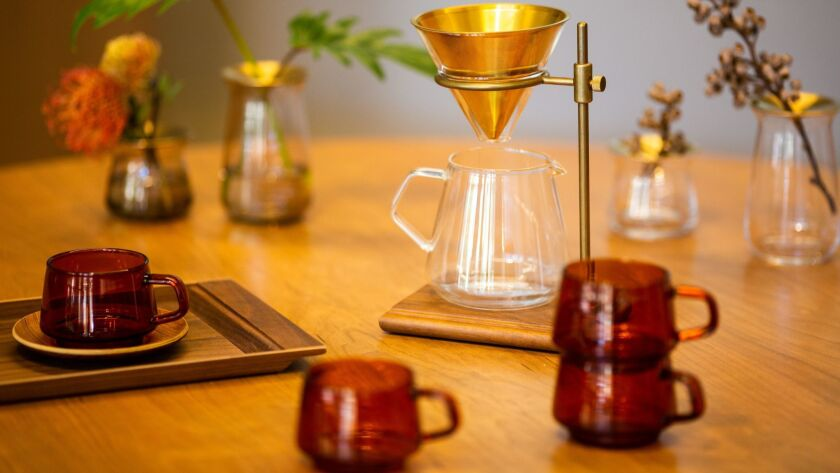 Glass drinkware and coffee dripper on display at Kinto.