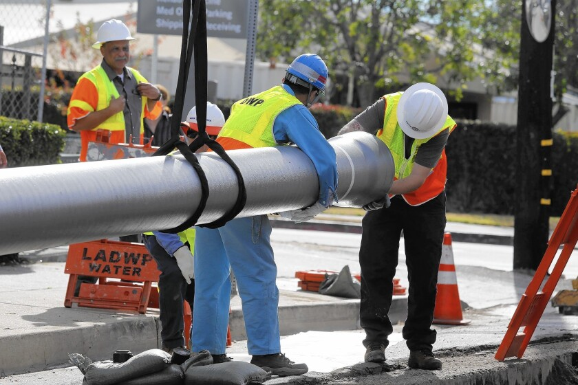 DWP workers install an earthquake-resistant water pipe