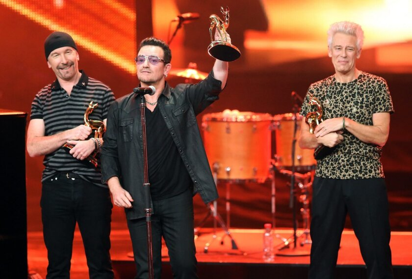 U2, with frontman Bono at center, accepts a prize in the international music category Bambi Awards in Berlin on Thursday.