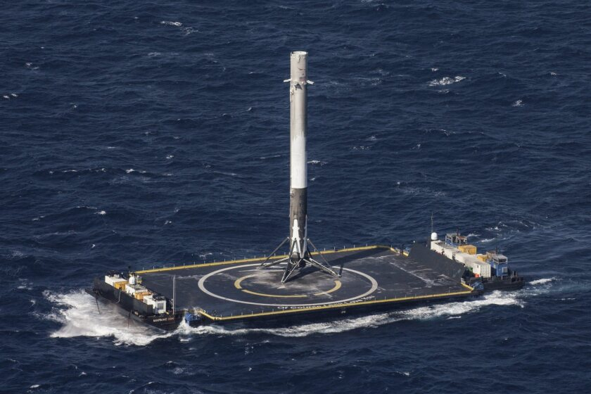 SpaceX landed its first-stage Falcon 9 rocket booster on a barge in the Atlantic Ocean on Friday.