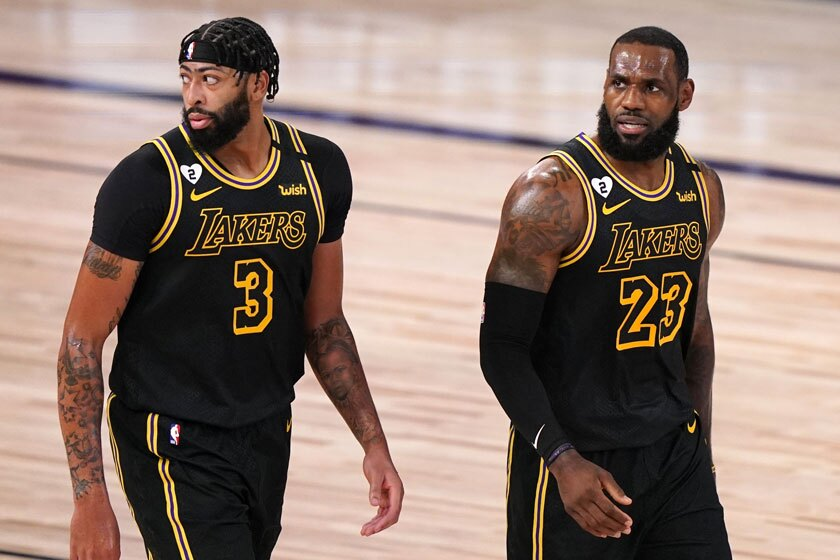 """The Lakers' Anthony Davis, left, and LeBron James will be in their """"Black Mamba"""" uniforms for Game 5, as they were in Game 2."""