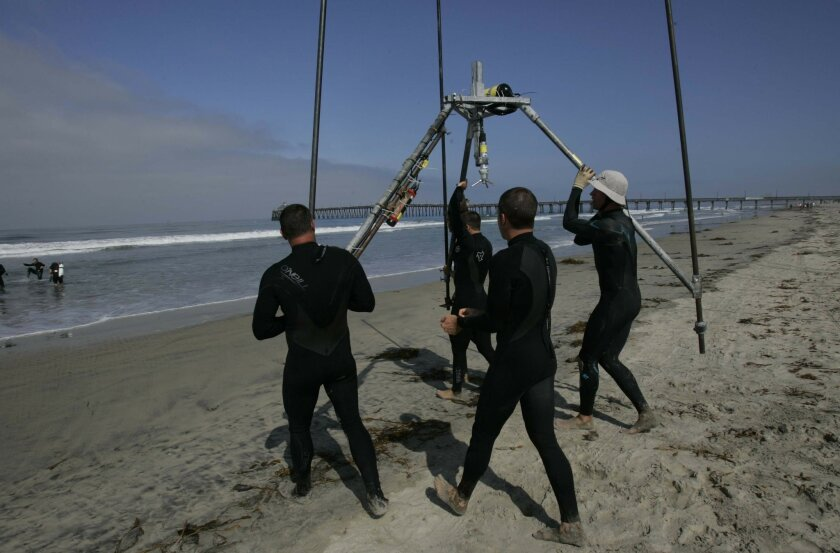 Scientists carried one of six tripods into the ocean. The monitoring equipment will relay information hourly to Scripps. <em>&#8201;</em>