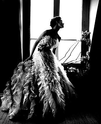 """Lillian Bassman shot this photograph, called """"Fantasy on the Dance Floor,"""" featuring model Barbara Mullen in a Christian Dior dress, for Harper's Bazaar in 1949."""