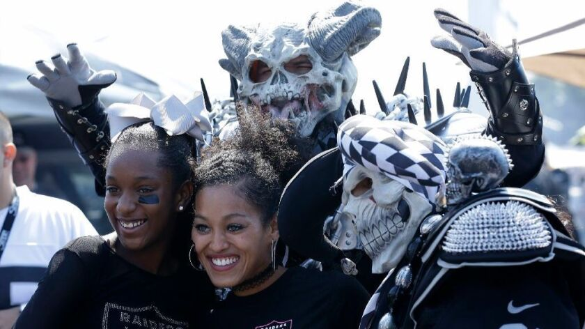 Raiders fans pose for a photograph before a preseason game against the Rams on Aug. 19.