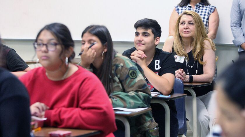New Glendale Unified School District Superintendent Vivian Ekchian sits at the back of a summer scho
