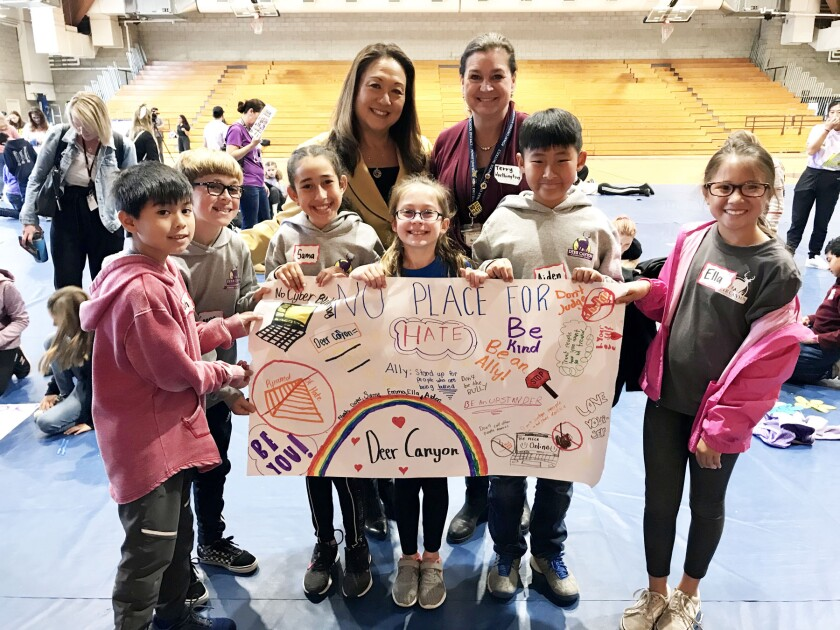 Supt. Marian Kim Phelps, top left, with staff and students of Deer Canyon Elementary School at a No Place For Hate event.