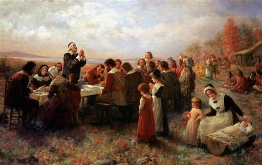 """FILE - This Tuesday, Nov. 15, 2005 photo shows a detail of the 1914 Jennie Brownscombe painting """"The First Thanksgiving at Plymouth"""" hanging at the Pilgrim Hall Museum in Plymouth, Mass. The painting is labeled at the museum as being historically inaccurate, noting that the clothes are incorrect, a"""