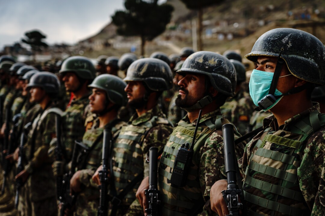 Afghan Army special forces commandos stand in formation.