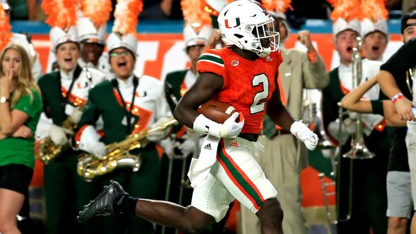 Defensive back Trajan Bandy, returning an interception against Notre Dame for a touchdown Saturday, and the Miami Hurricanes are heading in the right direction with a No. 2 ranking in the Associated Press college football poll.