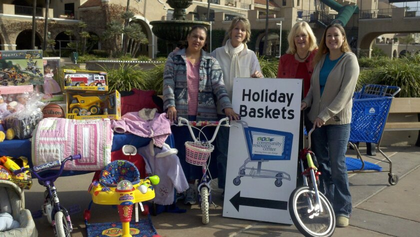 More than 2,000 local volunteers and 200 groups have helped collect for the Holiday Basket program each year. Courtesy photo