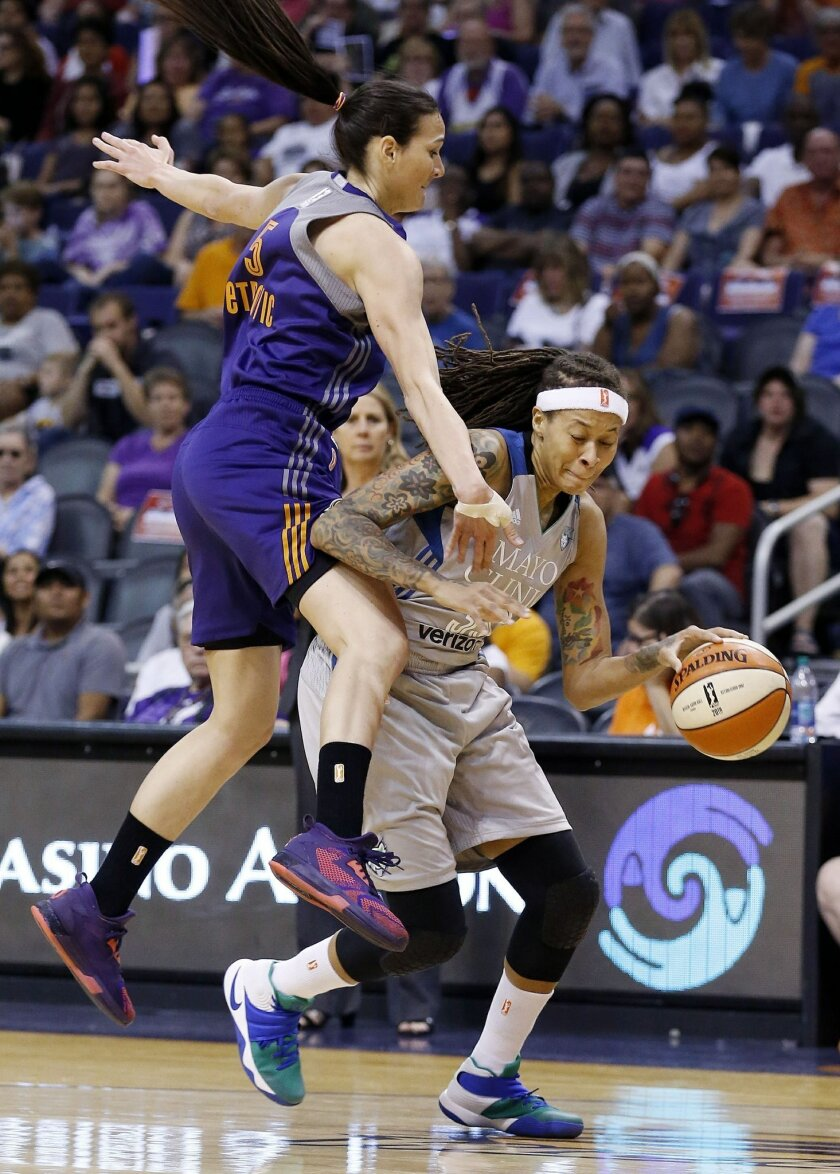 Minnesota Lynx's Seimone Augustus, right, tries to dribble past Phoenix Mercury's Sonja Petrovic (5) as they collide during the first half of a WNBA basketball game Wednesday, May 25, 2016, in Phoenix. (AP Photo/Ross D. Franklin)