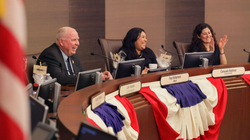 New Escondido Mayor Paul McNamara with new Councilmember Consuelo Martinez, middle, and Councilmember Olga Diaz, at right, acknowledge audience applause after Paul spoke at tonight's City Council me