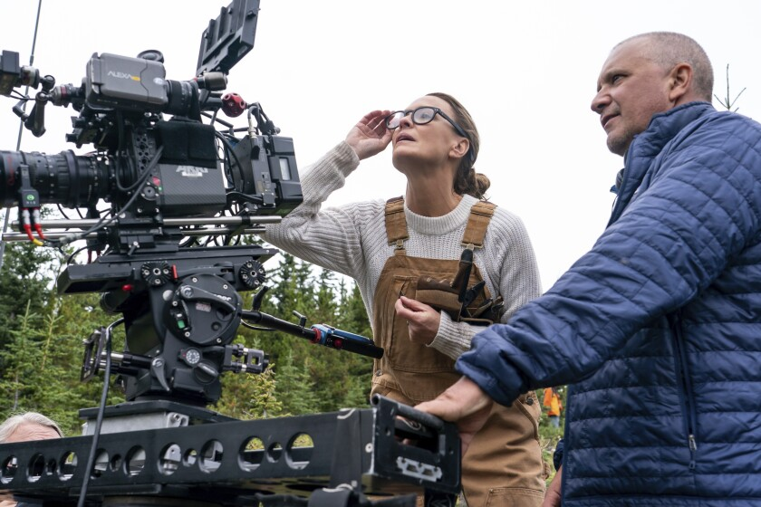 """This image released by Focus Features shows actor-director Robin Wright, left, and and director of photography Bobby Bukowski on the set of """"Land."""" (Daniel Power/Focus Features via AP)"""
