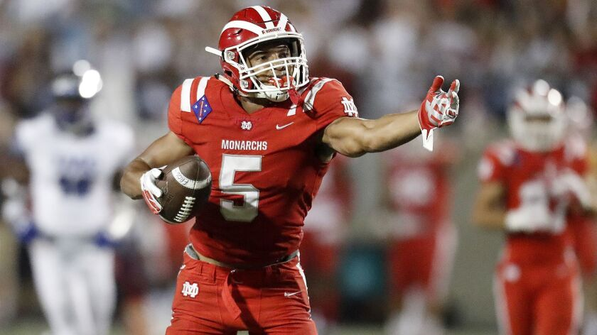 Mater Dei receiver Bru McCoy signals a first down after making a catch against IMG Academy on Sept. 21, 2018, at Santa Ana Stadium.