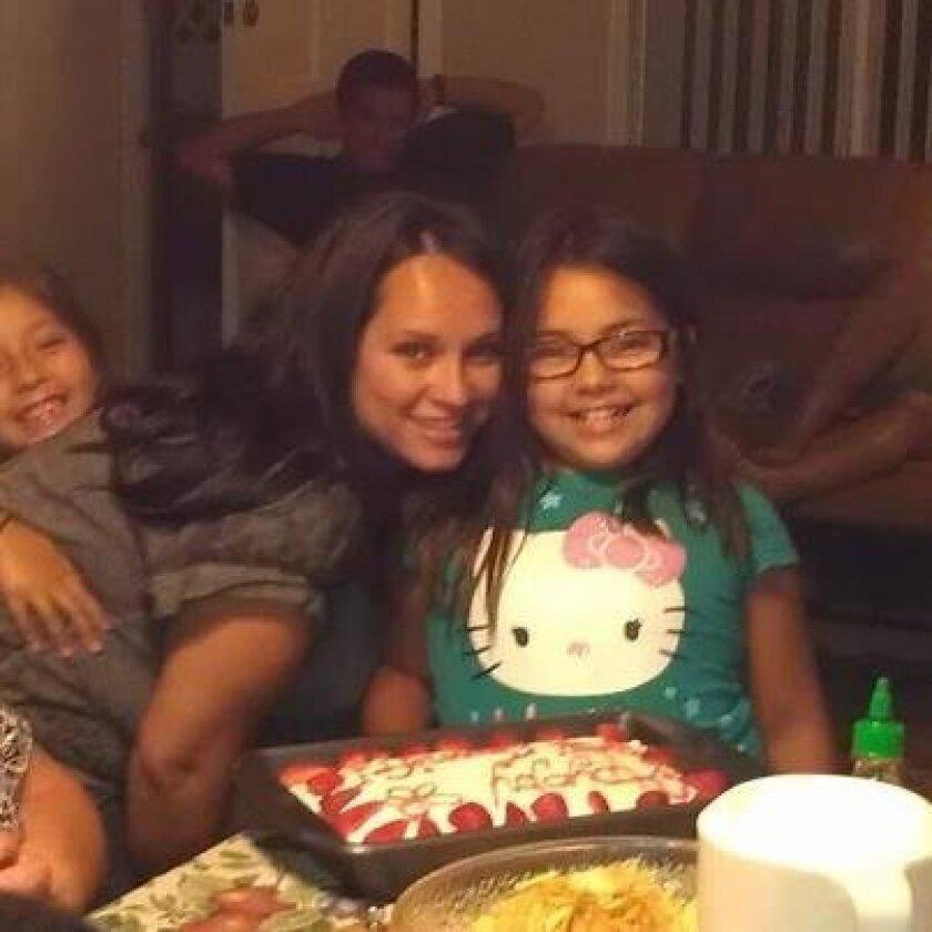 From left, Camryn, Mary and Jennifer Aguilar celebrating Jennifer's 9th birthday.