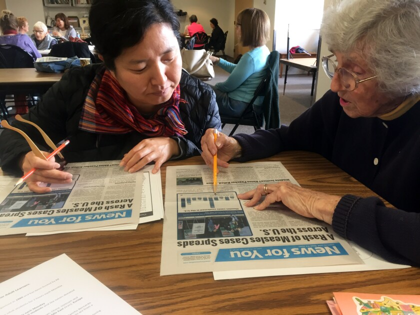 English language-learner Heejung Kim, left, and tutor Joyce Hartman, 87, go over an article in an easy-reader newspaper on Monday at the Rancho Bernardo Literacy Center.