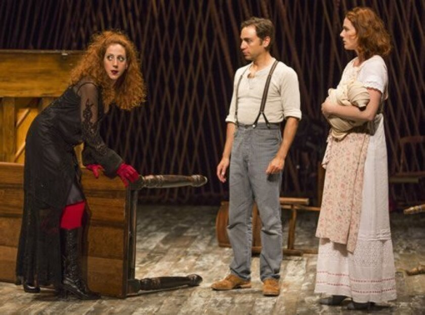 Alison Cimmet (Witch), Ben Steinfeld (Baker) and Jessie Austrian (Baker's Wife) negotiate a bargain in The Old Globe's staging of 'Into the Woods.' Jim Cox