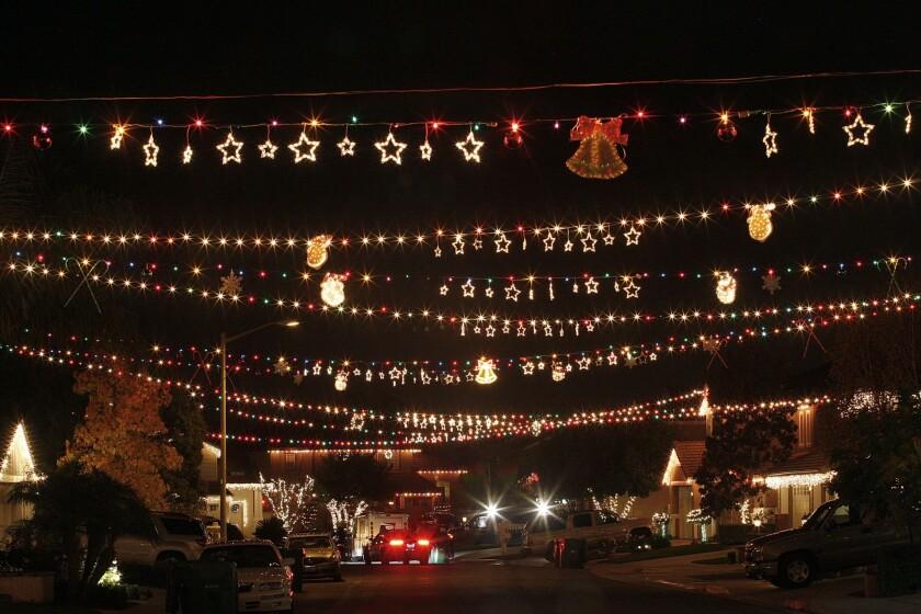 Christmas lights stretch across a street in Wagon Wheel, a hillside community in south Orange County.