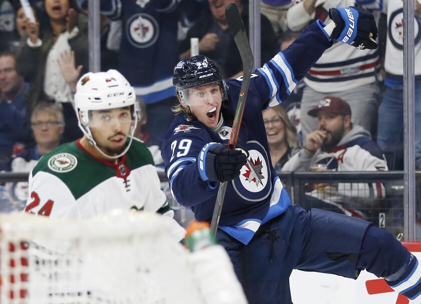 APTOPIX Wild Jets Hockey