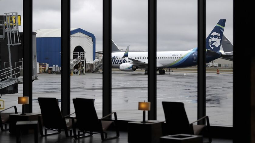 An Alaska Airlines plane sits outside the new passenger terminal at Paine Field in Everett, Wash. Alaska is offering $193 round-trip tickets to the airport, which is an alternative to Sea-Tac, for travel beginning March 5.