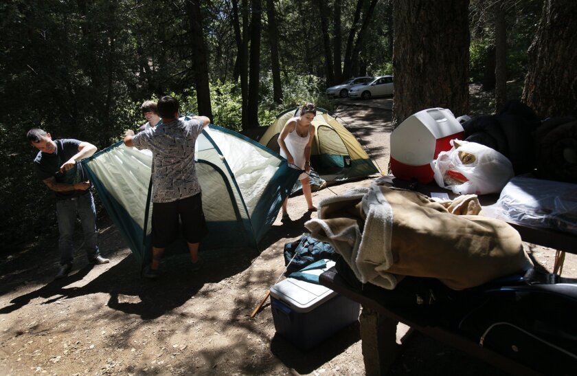 Campers at Palomar Mountain State Park which will remain open for at least the next three years under an agreement signed by the state Tuesday.
