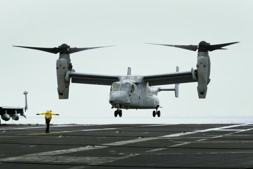 Sailors aboard the USS Carl Vinson and aviators from the Marine Corps are performing proof-of-concept work in the waters off San Diego this week. The Navy will transition to the V-22 tilt rotor Osprey for aircraft carrier delivers in the future. That means retirement of the venerable C-2 Greyhound,