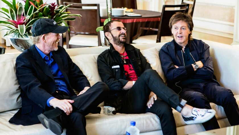 Beatles documentary producer and director Ron Howard, left, with Ringo Starr and Paul McCartney in Las Vegas