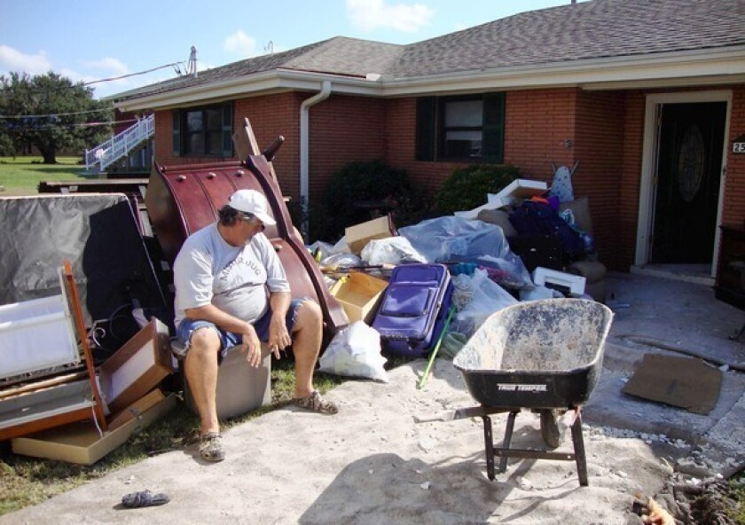 Ronald Dufrene surveys waterlogged furniture outside his flooded home in Jean Lafitte, La., a week after Hurricane Isaac. The community is outside New Orleans' post-Katrina hurricane protections.