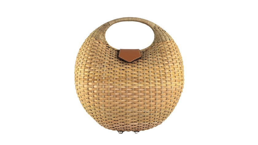 Kayu's woven wicker Elena bag makes a statement with its standout shape and magnetic leather-strap c