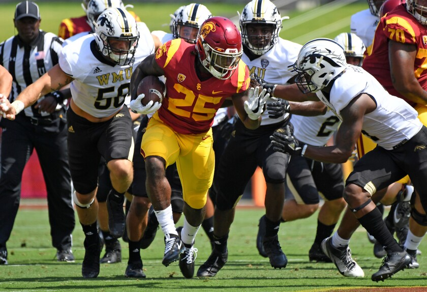 USC running back Ronald Jones II picks uo big yards against the Western Michigan defense during the first quarter at the Coliseum.