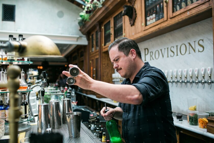 Bartender Erick Castro, co-owner of Polite Provisions, makes a drink at the North Park cocktail bar.