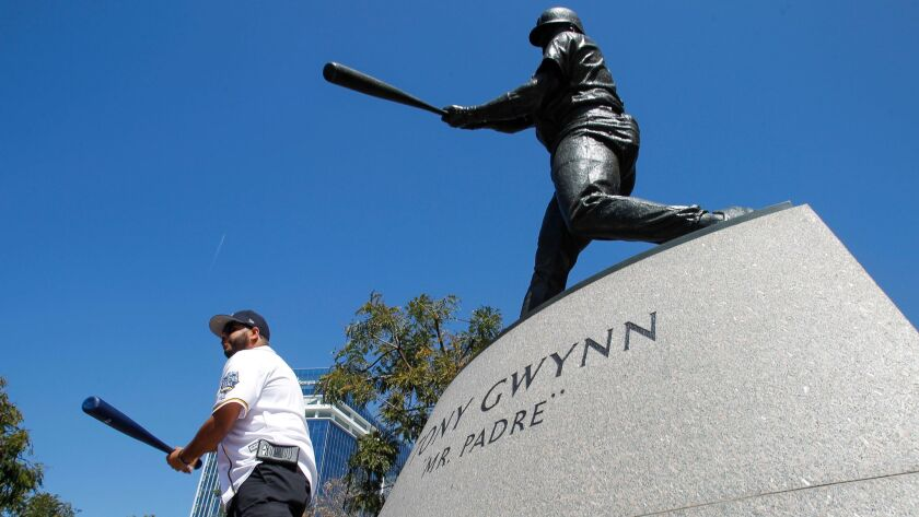 SAN DIEGO, April 1, 2017 | Marco Tapia holds his bat for a picture while next to the statue of Tony