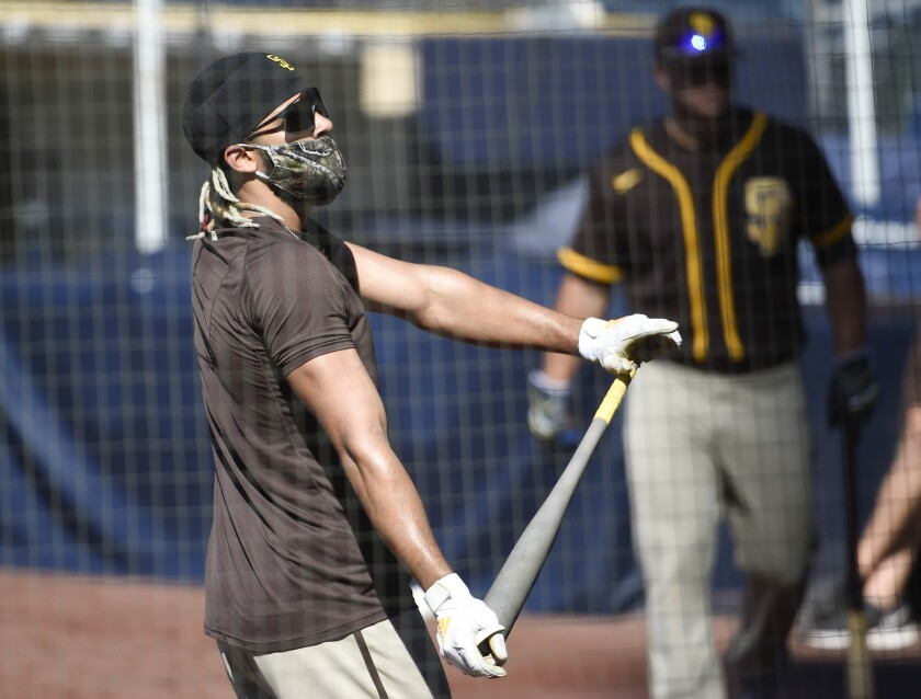Fernando Tatis Jr. dances during batting practice at the Padres' first workout of camp.