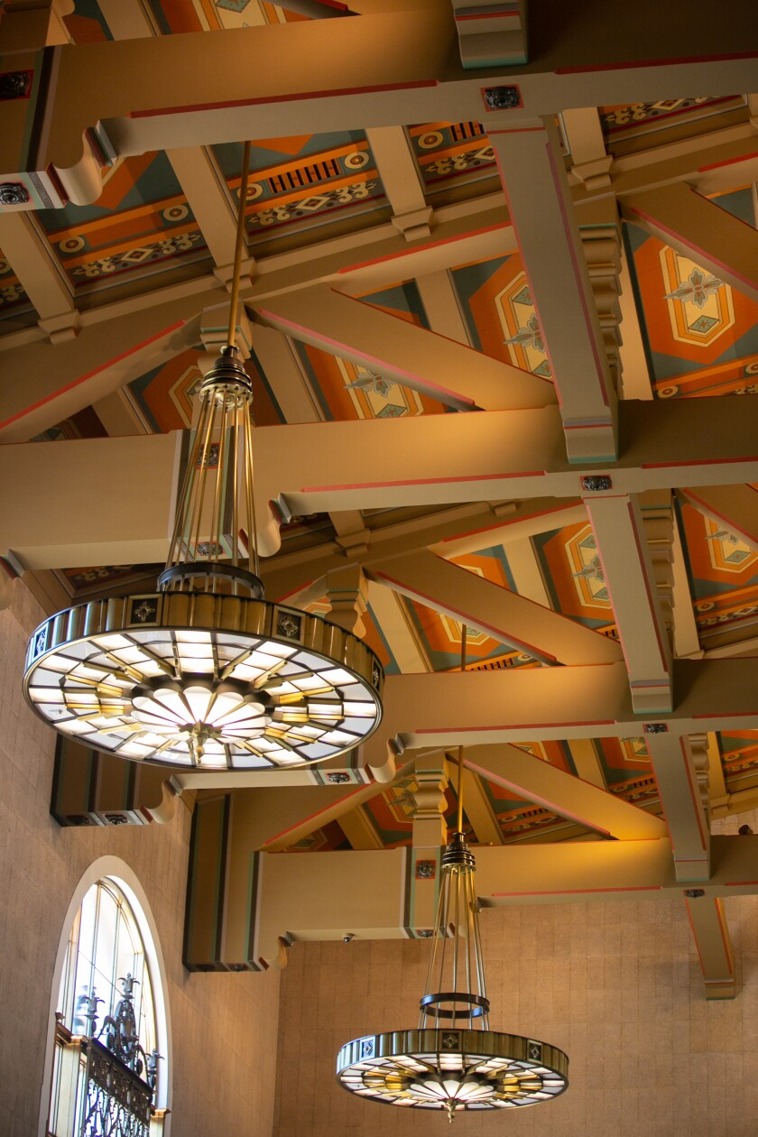 Lively ceiling panels and stained-glass chandeliers in the ticket concourse at Union Station.
