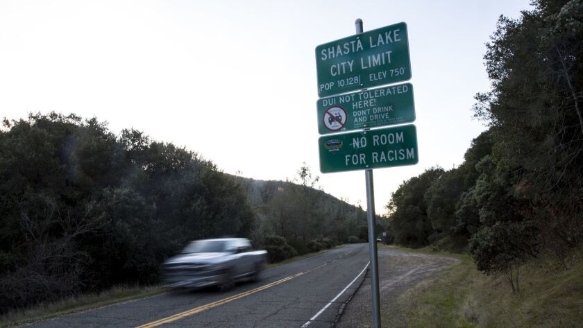 "A sign on Lake Boulevard in Shasta Lake, Calif., reads ""No Room for Racism."" Dozens of similar signs stand throughout Shasta County in Northern California."