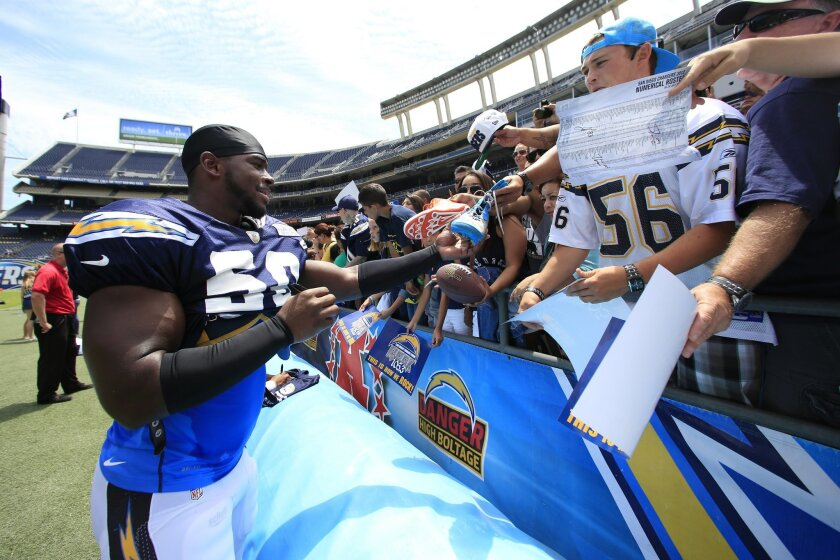 Donald Butler signs autographs after practice Saturday at Qualcomm Stadium. Fans should be hoping he soon signs a long-term contract as well.