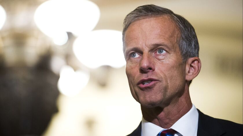 FILE - In this Sept. 5, 2018, file photo, Sen. John Thune, R-S.D., speaks with reporters after the R