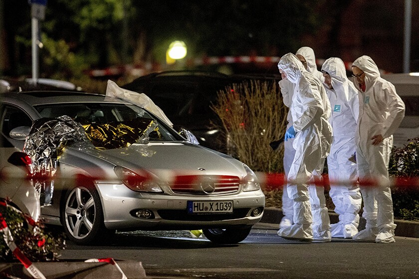 Forensic investigators at the scene after a shooting in central Hanau, Germany, on Thursday.