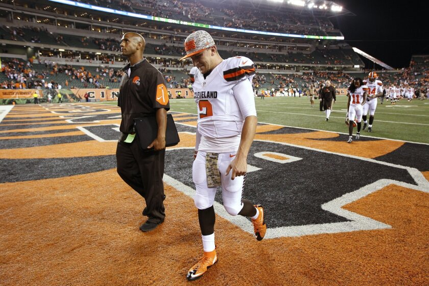 Cleveland Browns quarterback Johnny Manziel walks off the field after the Browns' 31-10 loss to the Cincinnati Bengals in an NFL football game Thursday, Nov. 5, 2015, in Cincinnati. (AP Photo/Frank Victores)