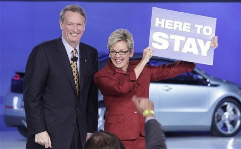 General Motors Corp. CEO Rick Wagoner, left, and Michigan Gov. Jennifer Granholm join a rally with GM employees at at the North American International Auto Show Sunday, Jan. 11, 2009 in Detroit. (AP Photo/Paul Sancya)