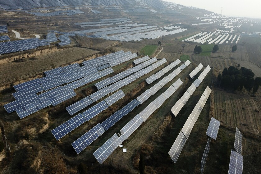 FILE - In this Nov. 28, 2019, file photo, a solar panel installation is seen in Ruicheng County in central China's Shanxi Province. China's government on Friday, June 25, 2021 criticized U.S. curbs on imports of solar panel materials that might be made with forced labor as an attack on its development and said Beijing will protect Chinese companies, but gave no details of possible retaliation. (AP Photo/Sam McNeil, File)