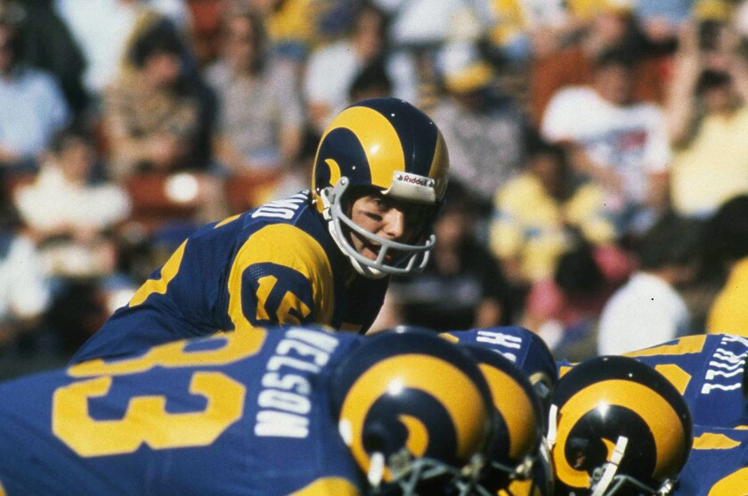 Rams quarterback Vince Ferragamo gets set to hike the ball during a game in 1980.