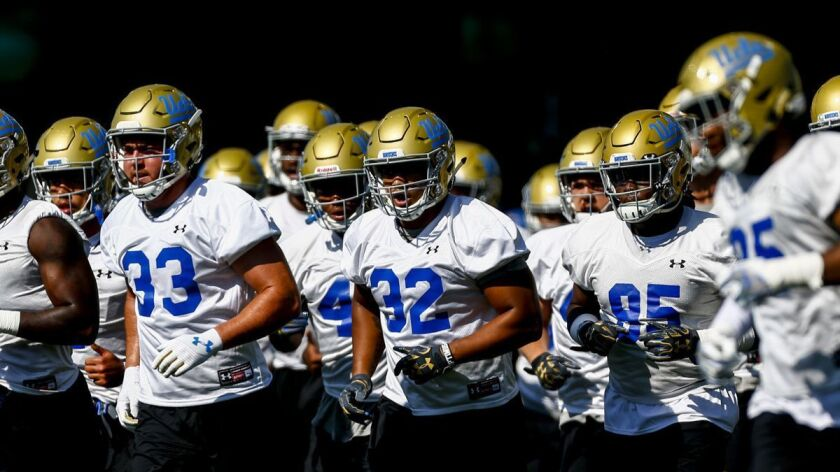 LOS ANGELES, CALIF. - AUGUST 03: UCLA Bruins linebacker Mique Juarez (32) and members of the defensi